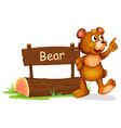 A bear standing beside a wooden board vector image