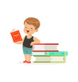 cute little boy reading a book next to a pile of vector image