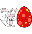 Happy rabbit painting easter egg vector image