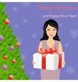 Girl with gift box near Christmas tree vector image