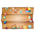 A wooden signboard surrounded with toys vector image vector image