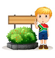 Little boy standing next to the sign vector image