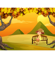 A girl at the bench in the park vector image