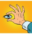 Retro hand holding eyes vector image