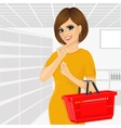 Thoughtful woman holding an empty shopping basket vector image
