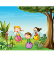 Three kids having fun with a bouncing ball vector image vector image