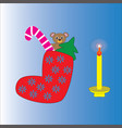 christmas sock and a burning candle vector image