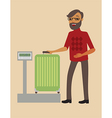 Passenger weighing his big suitcase vector image vector image