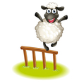 A sheep standing above the wooden fence vector image vector image