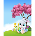 Cute Easter Bunny painting an egg vector image