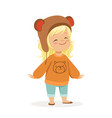 cute little blonde girl dressed in a brown bear vector image