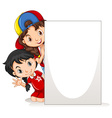 Two girls behind the blank paper vector image