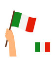 human hand holding flag of italy vector image
