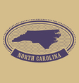 Oval stamp with North Carolina map silhouette vector image