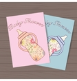 Set of baby showers with bottles on wooden vector image