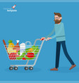 young man walking with shopping cart vector image