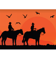 Cowboys silhouette at sunset vector image