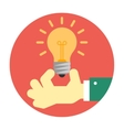 Hand holding a light bulb vector image