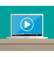 laptop on desktop with running web video player vector image