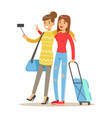two smiling tourists girl with suitcases standing vector image