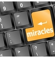 Computer keyboard with miracles text vector image