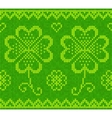 Patricks day green knitted sweater with clover vector image vector image