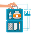 hand with first aid kit with medical tools vector image
