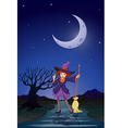 A witch at the road in the middle of the night vector image vector image
