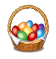 Colorful Easter eggs in straw basket vector image vector image