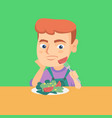 boy refusing to eat salad with healthy vegetables vector image