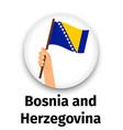 bosnia and herzegovina flag in hand vector image