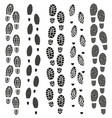 black footprints silhouette set vector image