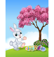 Cute Easter bunny walking with colourful Easter eg vector image vector image