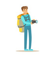 happy young man standing with backpack and holding vector image