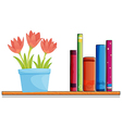 A wooden shelf with a pot of flower and books vector image