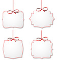 White paper gift cards with red satin bows vector image