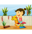 A little girl playing inside the fence vector image