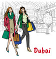 women in shopping mall vector image