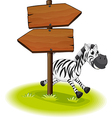 A zebra at the back of a wooden arrow board vector image