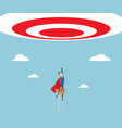 businessman in red cape flying to target vector image