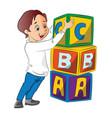 boy stacking alphabet blocks vector image
