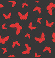 red butterfly on black background vector image