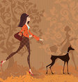 Fashion young woman and her dog are walking in the vector image