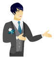 Young asian happy groom gesturing vector image