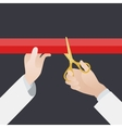 Hand with golden scissors cut the red ribbon vector image