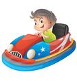 A young boy riding a bumper car vector image vector image