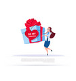 woman holding big gift box with heart shape label vector image