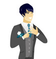 young asian groom showing golden ring on finger vector image