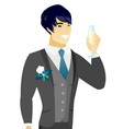 young asian groom holding glass of champagne vector image
