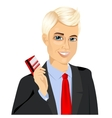 businessman with glasses holding a red credit card vector image
